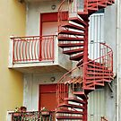 Winding staircase in red by Arie Koene