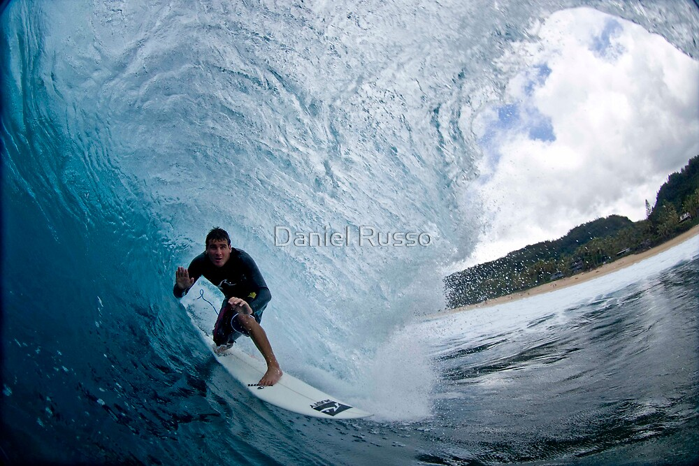 surfer on wave by Daniel Russo