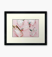Beautiful bottles dehami on a gentle pink background Framed Print
