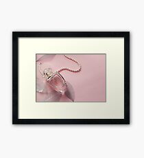 Women's perfume on a pink background with a decorative leaves Framed Print