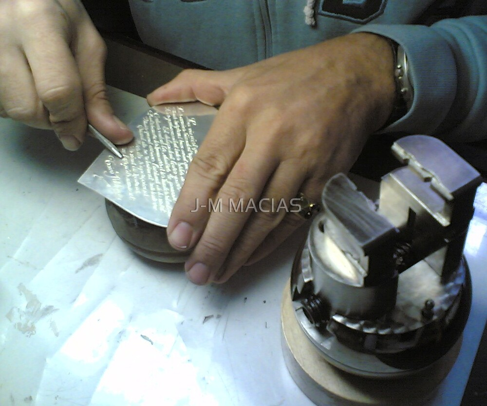 ENGRAVING HAND ON THE SILVER COIN by J-M MACIAS