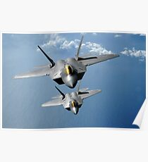 Two F-22 Raptors fly over the Pacific Ocean. Poster