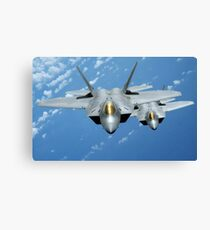 Two F-22 Raptors fly over the Pacific Ocean. Canvas Print