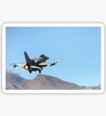 An F-16E from the United Arab Emirates taking off for a training mission at Nellis Air Force Base, Nevada. Sticker
