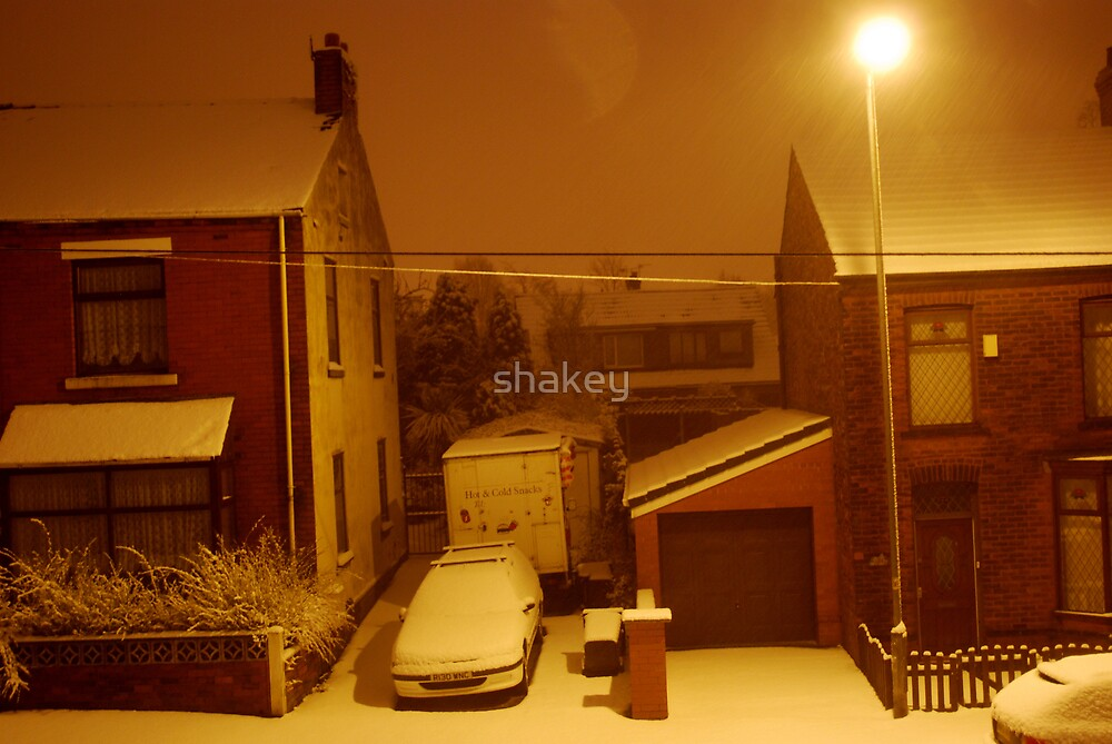 Snow in the glow of the streetlight by shakey
