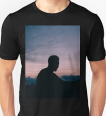 Silhouette during sunsets.  T-Shirt