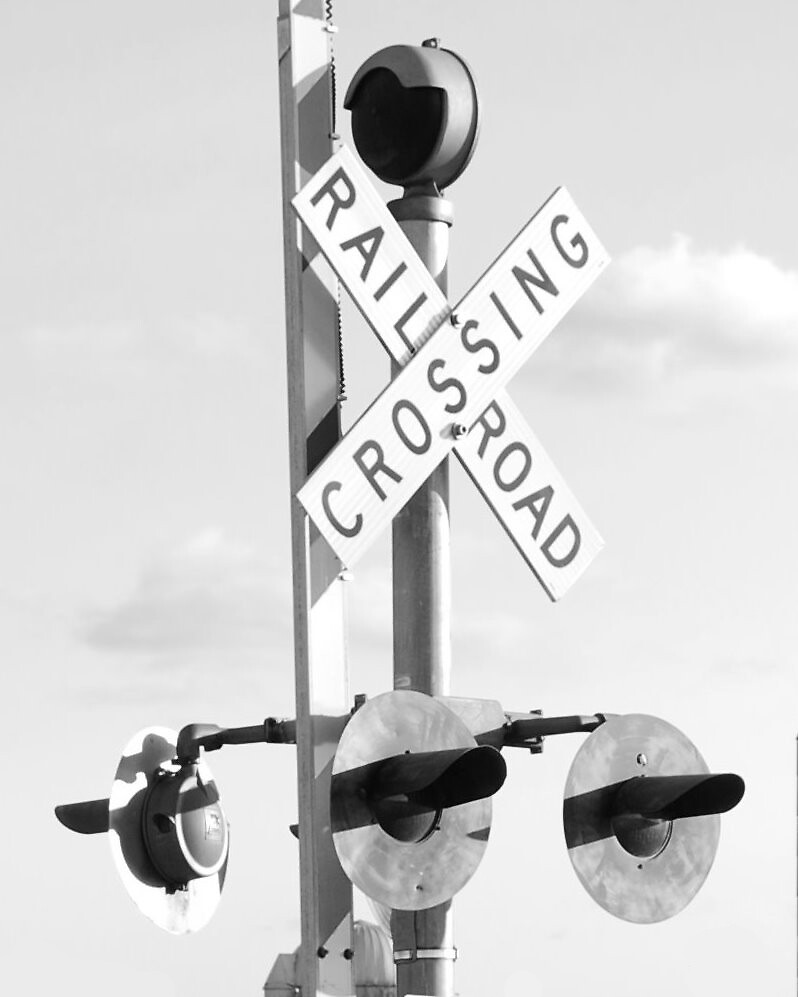 Railroad Crossing in Black and White by ericseyes