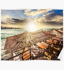 restaurant place at the sea shore at sunset Poster