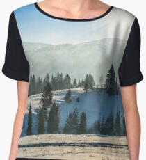 spruce forest on snowy meadow in high mountains Chiffon Top