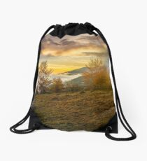 foggy and hot sunset in Carpathian mountains Drawstring Bag