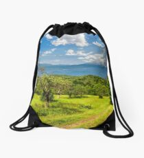 Winter in mountains meets spring in valley Drawstring Bag