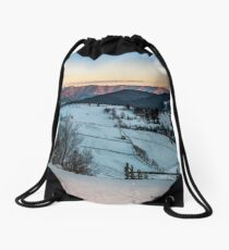 fence on snowy mountain slope near the forest in winter Drawstring Bag