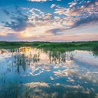 Sunrise across the lake  by Ralph Goldsmith