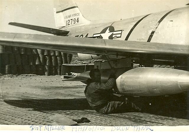 Me hanging a drop tank under wing by dummy