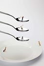 People Playing Golf On Spoons by Paul Ge