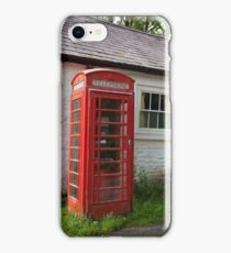 An old British phone box and a white washed building iPhone Case/Skin