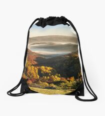 cold fog on hot sunrise in mountains Drawstring Bag