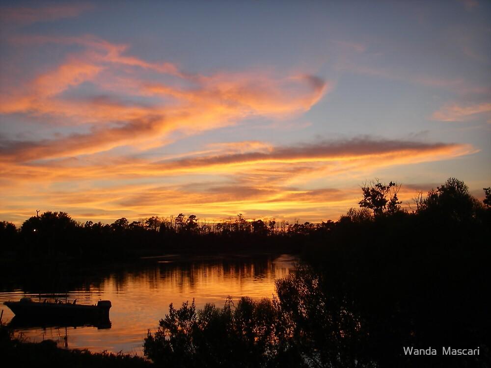 Sunset and Boat by Wanda  Mascari