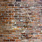 Brick wall with arrow by Scott Mitchell