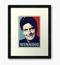 Winning, by Charlie Sheen Framed Print