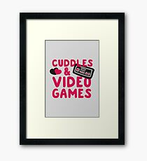 Cuddles and videogames Framed Print