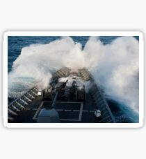 The bow of USS Cowpens plows through a wave in rough seas. Sticker