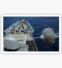 USS Philippine Sea fires its MK 45 5-inch lightweight gun. Sticker