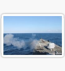 USS Mahan fires a 5-inch gun during a training exercise. Sticker