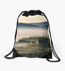 spruce forest on a hill side in fog Drawstring Bag
