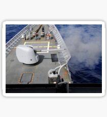 A Mk-45 5-inch .54-caliber gun is fired aboard USS Cowpens. Sticker
