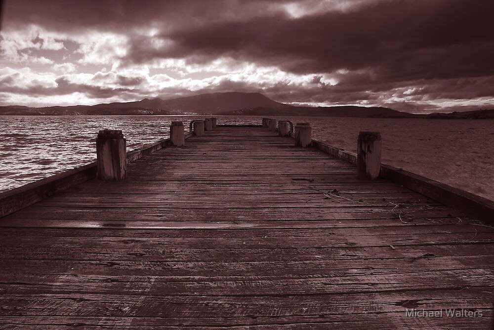 Jetty waits for storm by Michael Walters