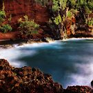 Red Sand Beach Cove by Philip James Filia