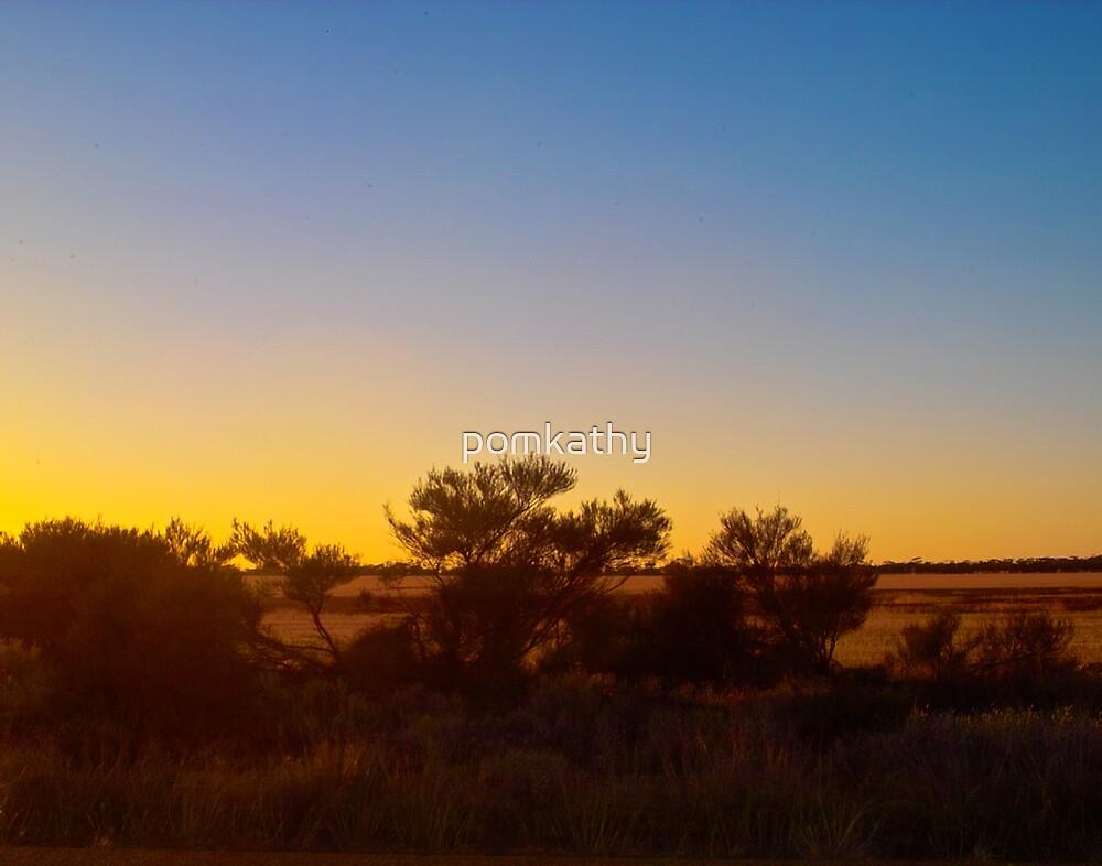 sunset over a dry paddock by pomkathy
