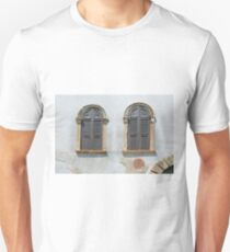 Two arched windows with shutters on an old wall Unisex T-Shirt