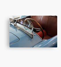 Detail of hood with windshield and steering wheel of blue car Canvas Print