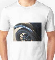 Close up on black vintage car wheel Unisex T-Shirt