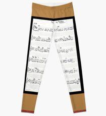 Piano keys with sheet music by Kristie Hubler Leggings