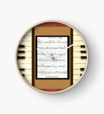 Piano keys with sheet music by Kristie Hubler Clock