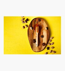 Honey dipper with nuts and spices  Photographic Print