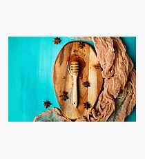 Honey with special spoon on a chopping board Photographic Print