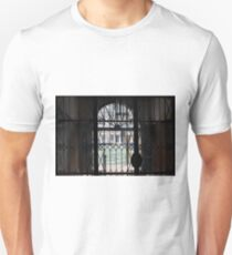 View of canal in Venice, Italy from a window with bars and arch Unisex T-Shirt