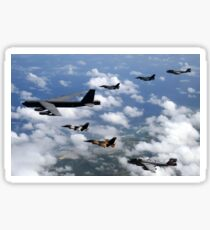 A B-52 Stratofortress leads a formation of aircraft over Guam. Sticker