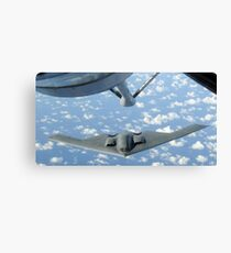 A B-2 Spirit approaches the refueling boom of a KC-135 Stratotanker. Canvas Print