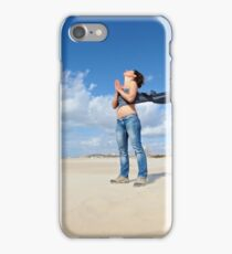 Spiritual young woman communicates with the spirits on a beach iPhone Case/Skin