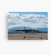 A B-52 Stratofortress takes off from Nellis Air Force Base. Canvas Print