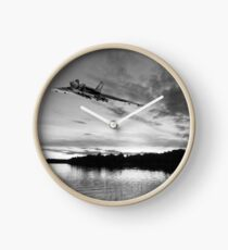 Vulcan low over a sunset lake B&W version Clock