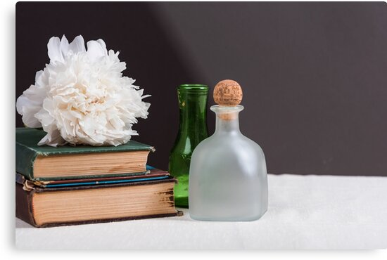 Vintage bottles, books and peony flower by nscphotography