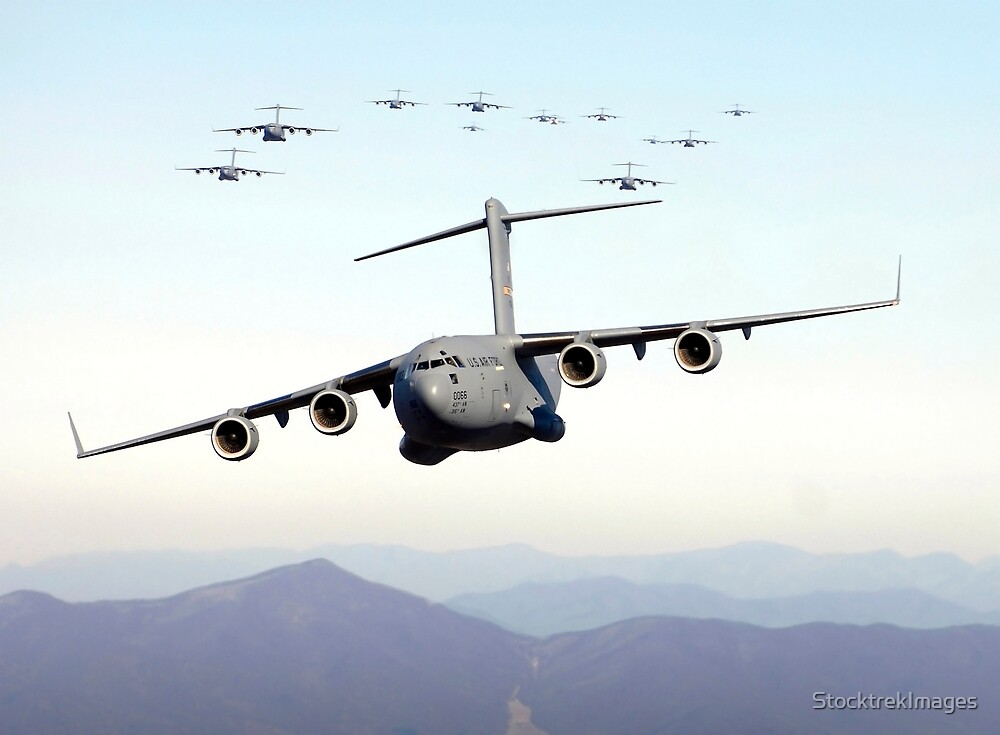 A formation of 17 C-17 Globemaster IIIs fly over the Blue Ridge Mountains. by StocktrekImages