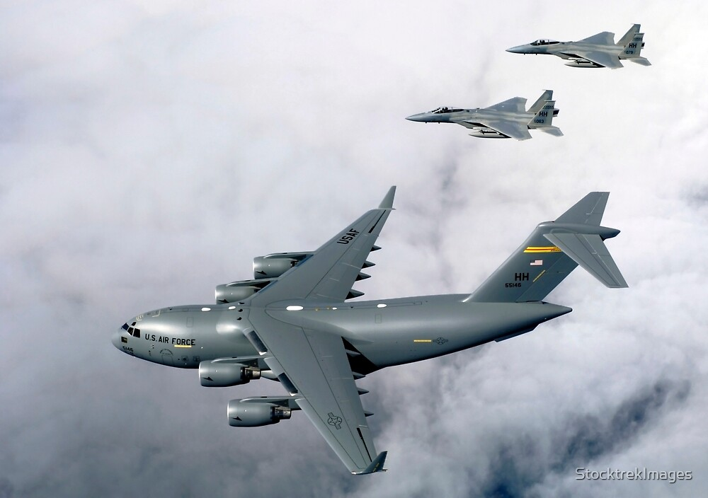 F-15B Eagles escort the first Hawaii-based C-17 Globemaster III to its home. by StocktrekImages