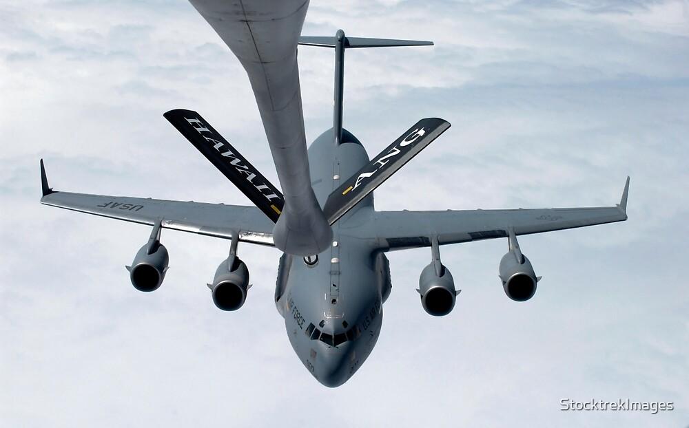 A C-17 Globemaster III prepares to refuel. by StocktrekImages
